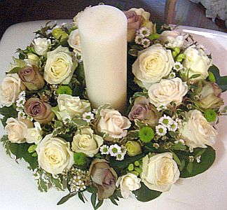 Flower Center Table Arrangement Made Of Mixed Coloured Roses